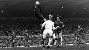 Chelsea goalkeeper Peter Bonetti leaps high to grab the ball from Jack Charlton