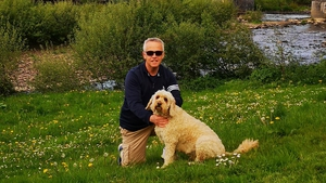 Joe Stack with his dog Mossie on the bank of the river Feale in Listowel.