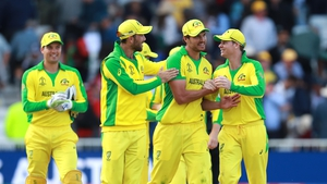 Nathan Coulter-Nile (C) of Australia is congratulated by team mates after their victory during the Group Stage match of the ICC Cricket World Cup 2019