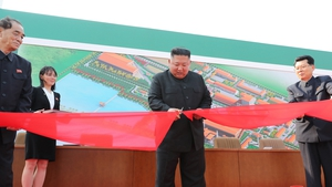 Kim Jong-un pictured cutting the ribbon at the opening of what state media said was a fertiliser factory