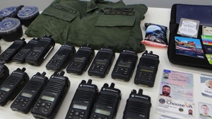 Authorities showed ID cards and equipment of people linked to the operation