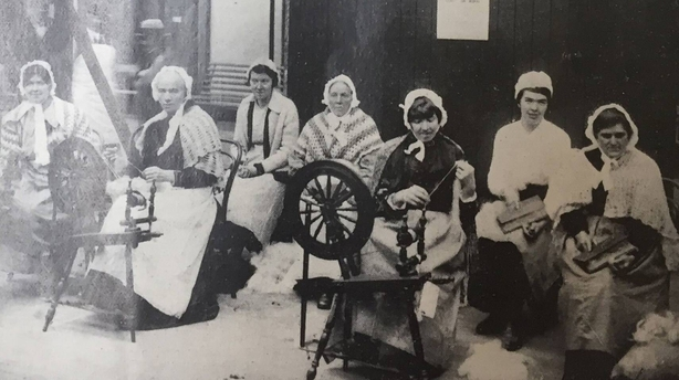 Flax spinners at work in the Art Industries' Hall. Photo: Irish Life, 14 May 1920