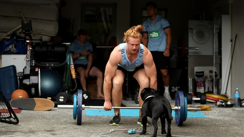 Flatmates and team-mates Stephen Perofeta, Finlay Christie and Tom Robinson of the Blues pictured during a weights session in their Auckland garage