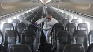 Workers disinfect an airplane at Denver International Airport. Photo:Aaron Ontiveroz/ MediaNews Group/The Denver Post via Getty Images