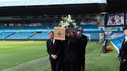 Norman Hunter's coffin is carried onto the pitch at Elland Road