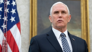 An aide to Mike Pence has tested positive for the cornavirus