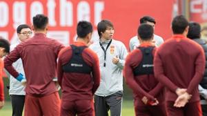 Coach Li Tie with his squad