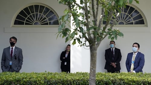 Staffers at the White House wear masks