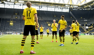 Erling Haland celebrates with teammates after giving Borussia Dortmund the lead against Schalke