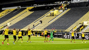 Dortmund players salute the empty stands after their 4-0 win over Schalke