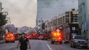 230 emergency responders battled the blaze as it spread to other buildings in the area