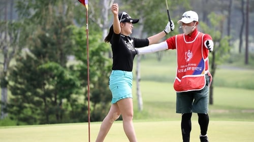Park Hyun-Kyung celebrates her victory on the 18th