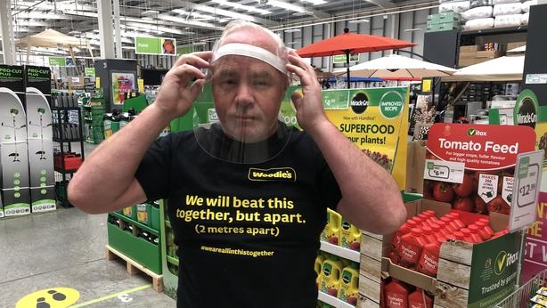 Woodies worker Noel Mulqueen tries his visor for size