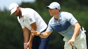 Dustin Johnson and Rory McIlroy (r)