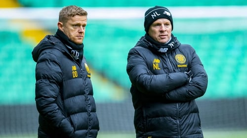 Celtic manager Neil Lennon (R) and first-team coach Damien Duff
