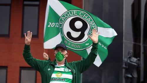 A fan celebrates after Celtic were crowned Scottish Premiership champions