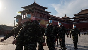 People's Liberation Army (PLA) soldiers march in front of the entrance of the Forbidden City in Beijing