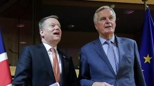 European Union chief Brexit negotiator Michel Barnier (R) and the British Prime Minister's Europe adviser David Frost