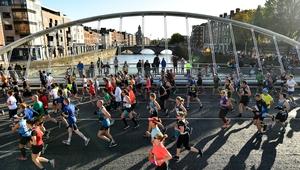 Runners cross James Joyce Bridge during the 2019 Dublin marathon.