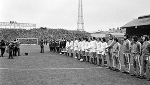 Republic of Ireland and Soviet Union players stand together for the national anthems ahead of the game.