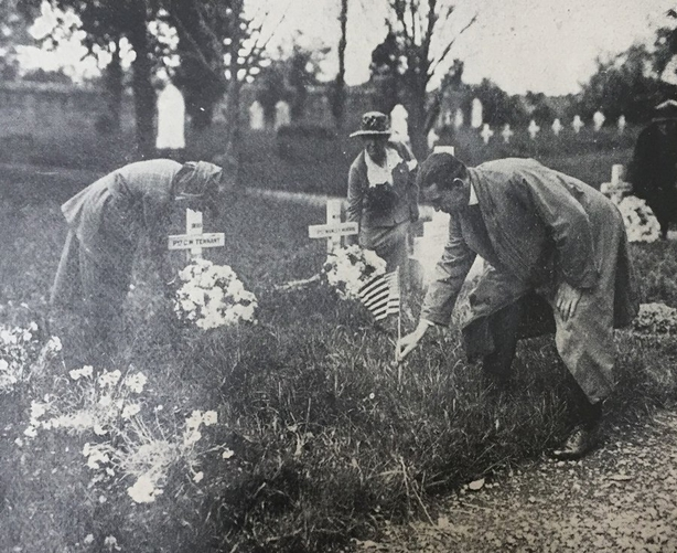 Ma Van Dine, the American vice-consul in Dublin, decorating the graves of American soldiers at Grangegorman Cemetery. A wreath and a small American flag was placed on each grave. Photo: Irish Life, 4 June 1920. Full collection available at the National Library of Ireland