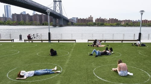 The circles, painted on the grass, allow picnickers and sunbathers stay a safe distance from each other
