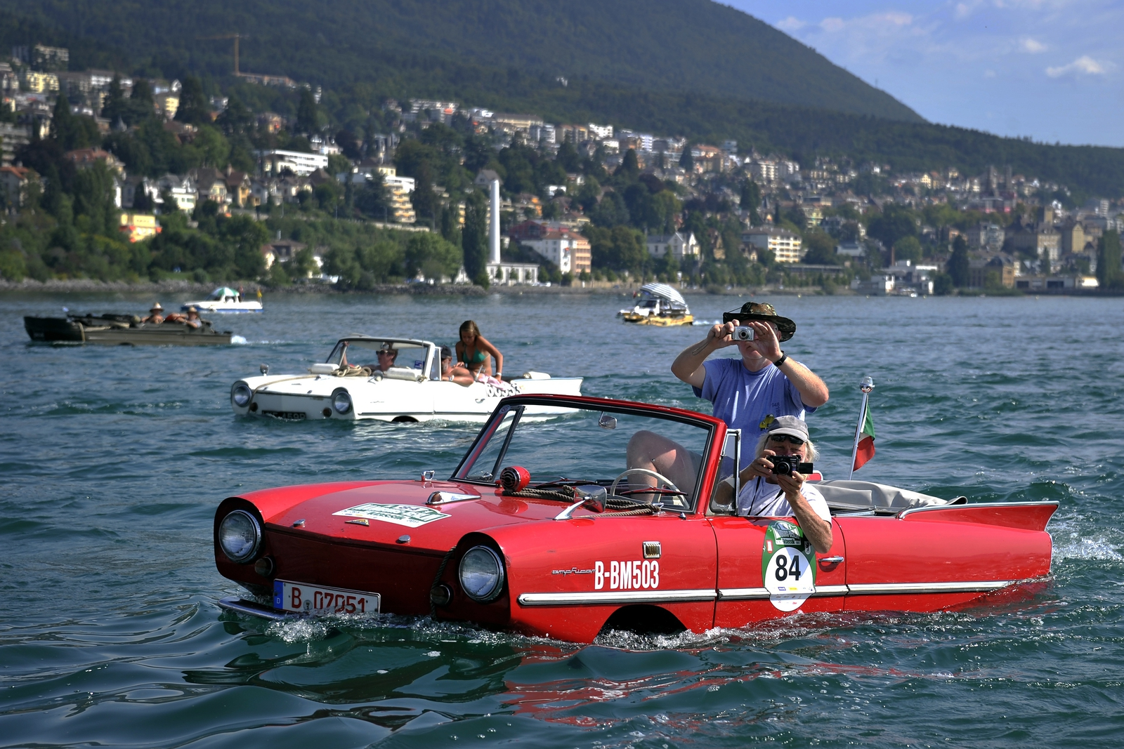 Image - Amphibious cars motor across Lake Neuchatel in 2011
