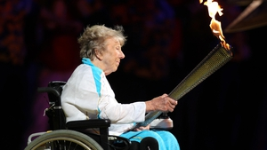 Margaret Maughan lights the flame of the London 2012 Paralympics