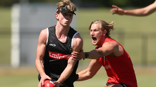 Anton Tohill (left) of Collingwood Magpies will be back in Australia on Saturday