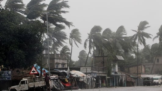At least 22 dead as cyclone hits Bangladesh and India