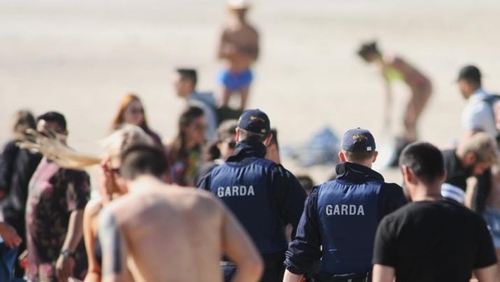 Gardaí were called to a beach in Sutton in north Dublin yesterday to break up one large crowd of people