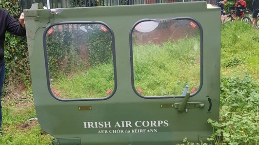 Air Corps helicopter door falls off and lands in school grounds