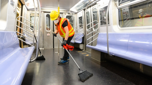 A cleaning contractor cleans and disinfects a New York City subway car
