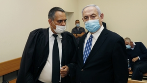 Benjamin Netanyahu (R) faces corruption charges