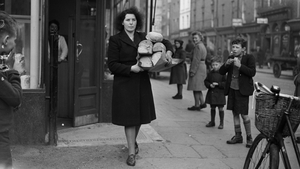 Anyone for some sourdough? A woman leaves a Dublin bakery in the 1940s with all the bread. Photo: J. Merriman/Keystone Features via Gerry Images