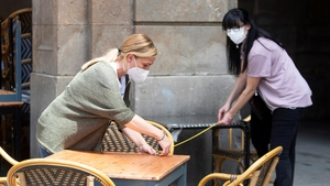 Preparations for the reopening of a cafe in Barcelona