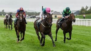 Siskin and Colin Keane (pink cap) triumph in the Keenland Phoenix Stakes