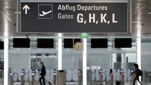 Travellers at Munich's Franz-Josef-Strauss International Airport