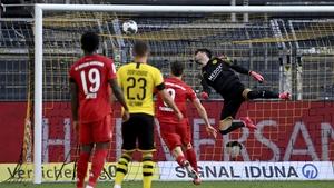 Borussia Dortmund goalkeeper Roman Buerki is beaten by Joshua Kimmich's brilliance