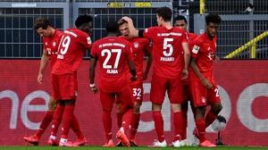 Joshua Kimmich celebrates with his Bayern Munich team-mates after his goal against Borussia Dortmund