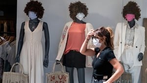 A shop window with masked mannequins in Mulhouse, eastern France