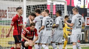 Leverkusen's Kai Havertz (2nd L) celebrates with his teammates after scoring