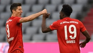 Robert Lewandowski (L) and Alphonso Davies both found the net