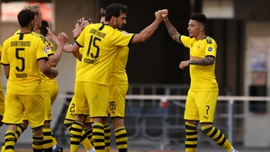Jadon Sancho celebrates scoring his teams third goal of the game