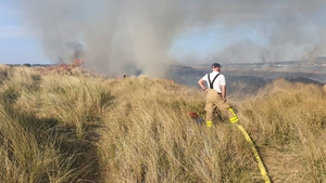 A picture from the Dublin Fire Brigade twitter account showing a crew member in action in Dollymount, Dublin