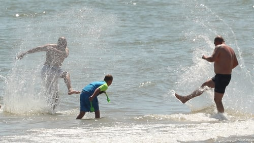 People splash in the sea at Brittas Bay in Co Wicklow