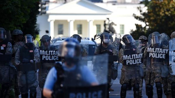 Military Police members guard the perimeter near the White House