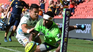 Highlanders player Tiveta Nabura (right) attempts to score against the Waikato Chiefs in 2018