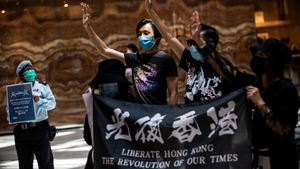 Pro-democracy protesters gather during a 'Lunch With You' rally at a shopping mall in the Central district of Hong Kong