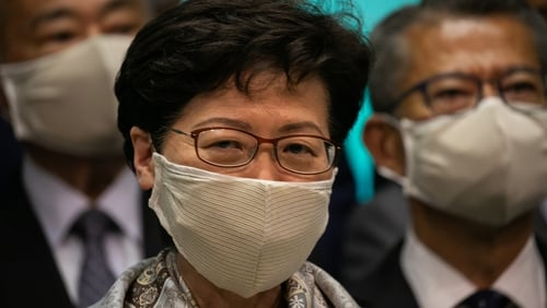 Carrie Lam's move comes after 12 pro-democracy candidates were disqualified from running in the poll